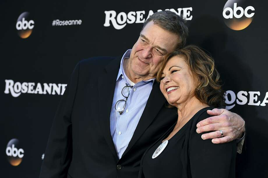 "FILE - In this March 23, 2018 file photo, John Goodman, left, and Roseanne Barr arrive at the Los Angeles premiere of ""Roseanne""  in Burbank, Calif.   ABC has cancelled its hit reboot of ""Roseanne"" following her racially insensitive tweet about former Obama adviser Valerie Jarrett, Tuesday, May 29.  ABC Entertainment President Channing Dungey said the comment ""is abhorrent, repugnant and inconsisten with our values, and we have decided to cancel the show.""  (Photo by Jordan Strauss/Invision/AP, File) Photo: Jordan Strauss, Associated Press"