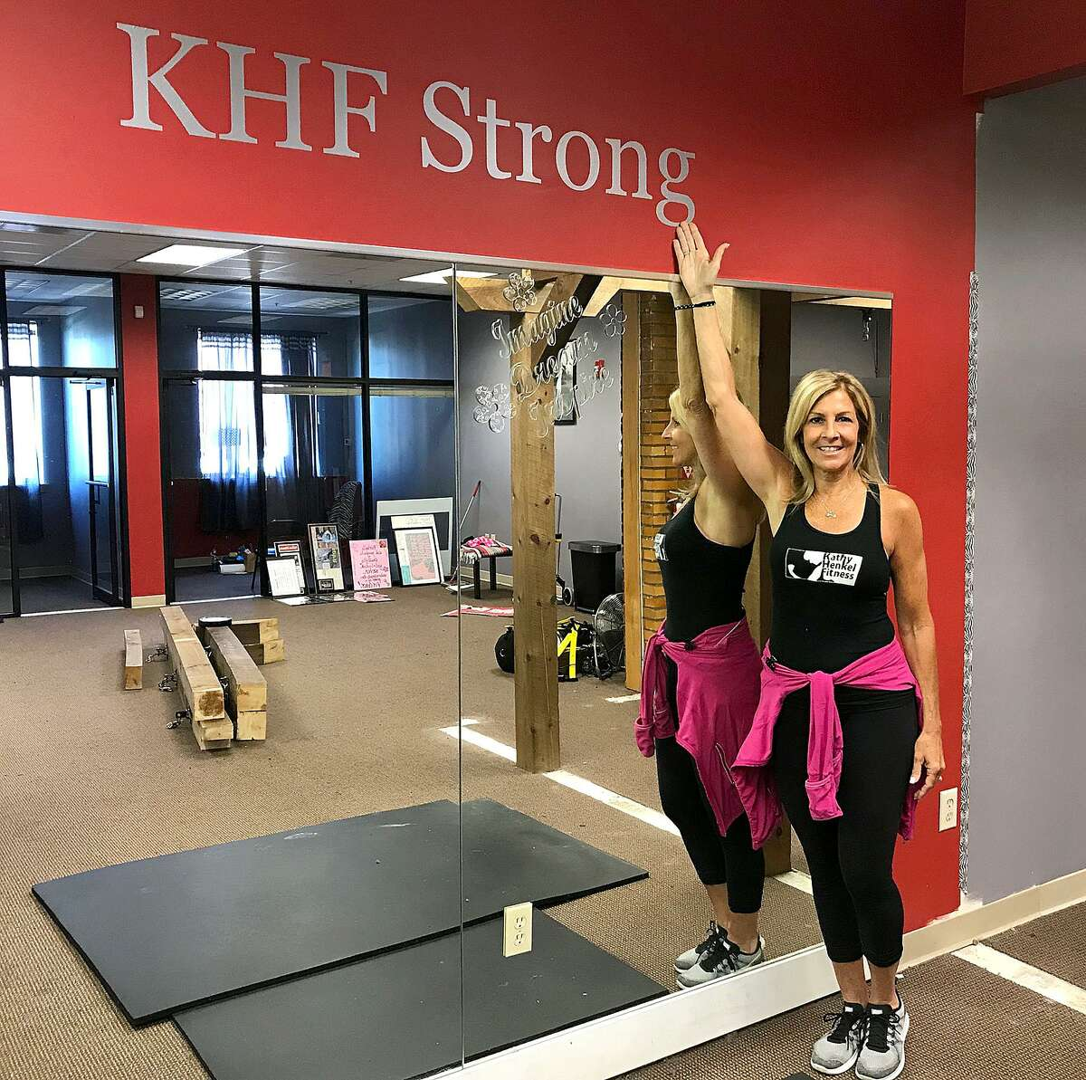 Kathy Henkel stands in her fitness studio in New Milford, Conn., on Tuesday, May 29, 2018. Kathy Henkel Fitness will close its doors after eight years in business on Wednesday.