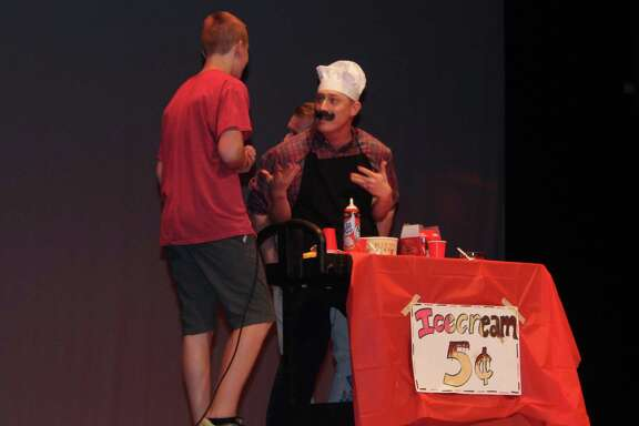 Woodcreek Middle School principal Bryan Applegate performs a comedy scene with teacher Tyler Dennis and a Woodcreek student during the Teacher Talent Show at Summer Creek High School on Thursday, May 24.