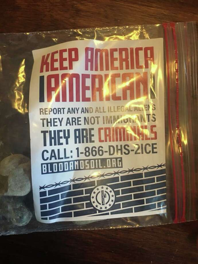 The flyers, which urge residents to report undocumented immigrants to Immigration and Customs Enforcement, were sealed in plastic baggies and weighed down with small stones. At the bottom of the flyer is a phone number for ICE and the URL for Blood and Soil's website. Photo: Tannya Lee/Facebook