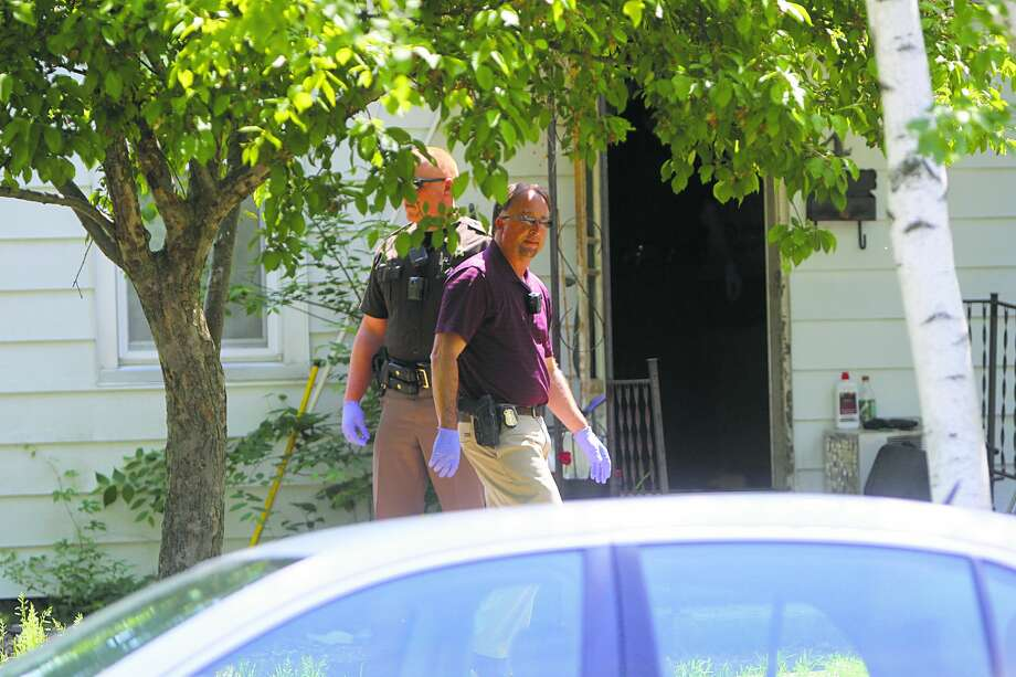Officers are pictured at the scene of an alleged attempted arson. Photo: Seth Stapleton/Huron Daily Tribune