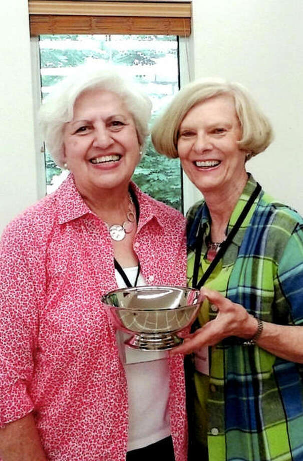 Bernie Wickenhauser, right, receives the prestigious Silver Bowl from Janet Hansen, placement chair. Photo:       For The Telegraph