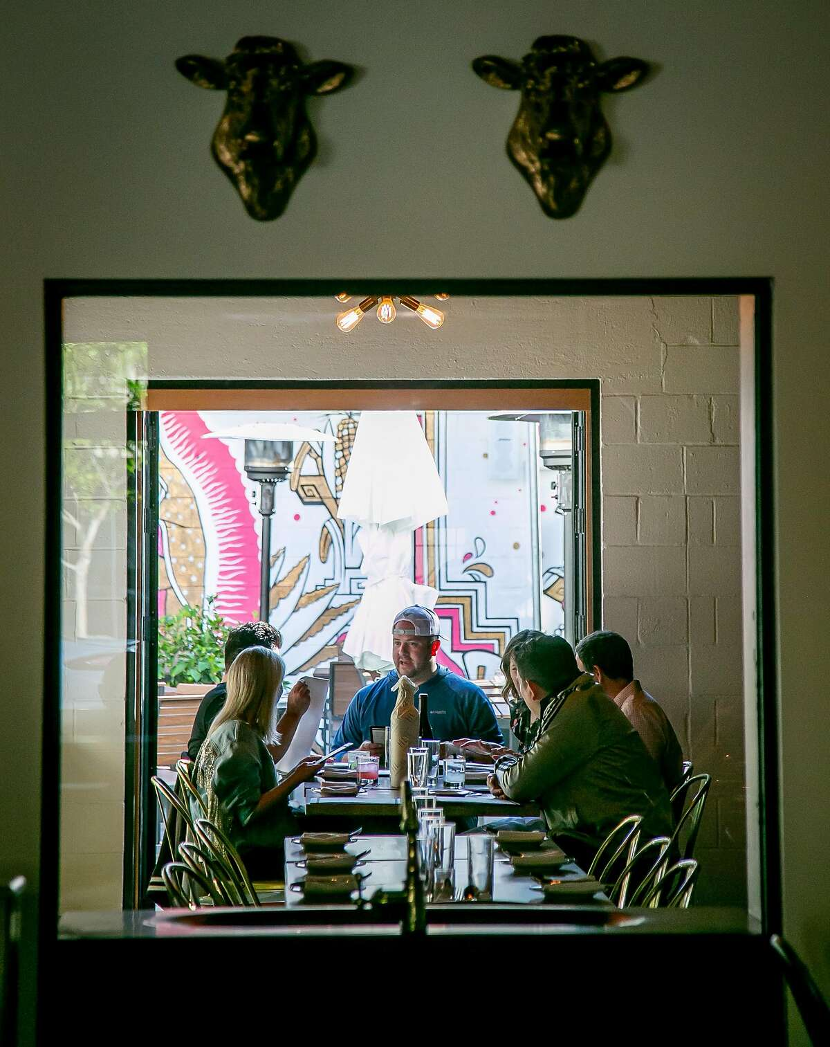People have dinner at Gran Electrica in Napa, Calif., on May 26th, 2018.