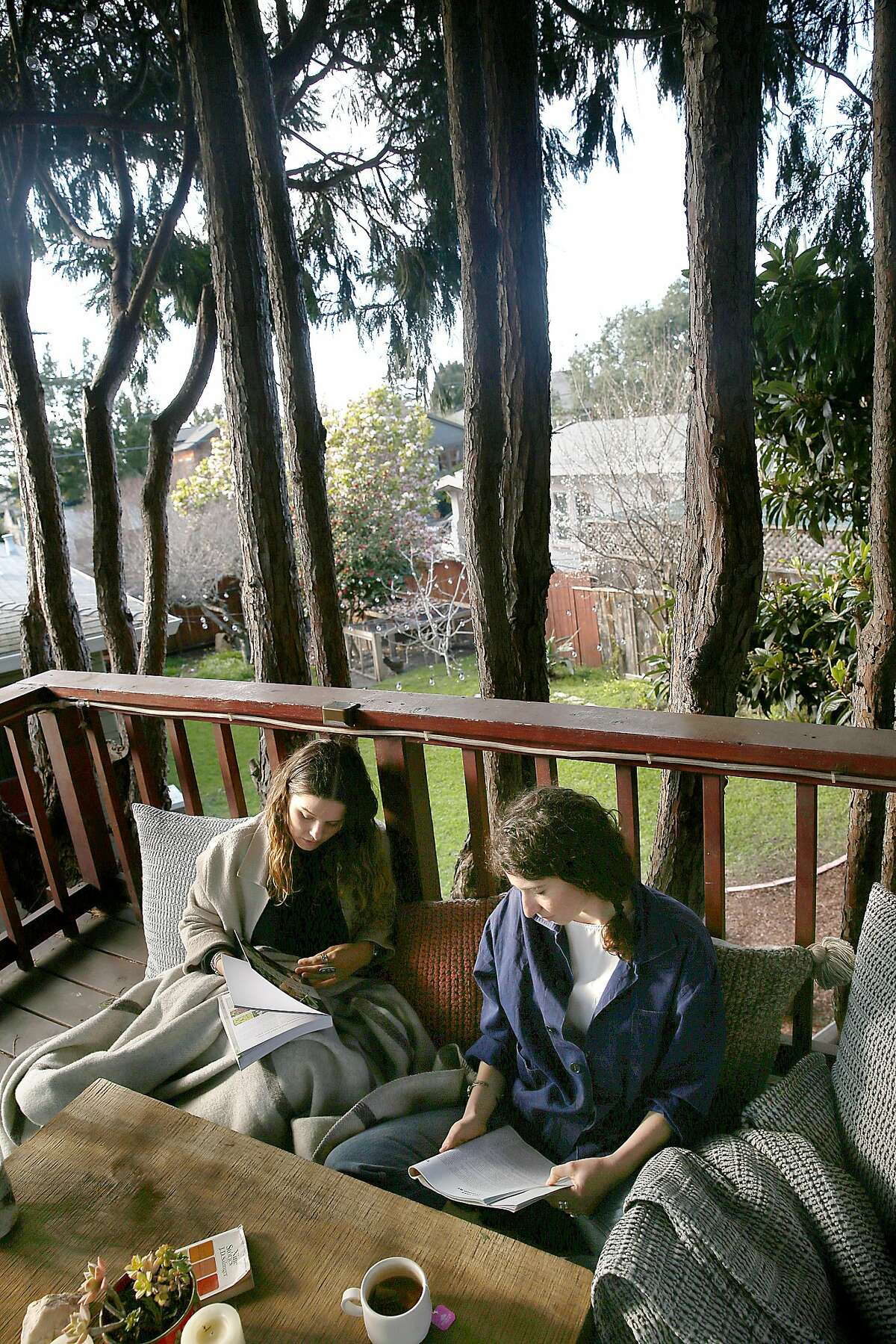 Lauren Tackberry and room mate Austin Sherman on the treehouse in the yard on Thursday, February 22, 2018, in Berkeley, Calif.