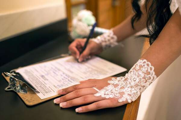Rakhi Patel signs marriage documents she and her partner Heren Patel came to file at City Hall on Friday, May 11, 2018. San Francisco Calif.