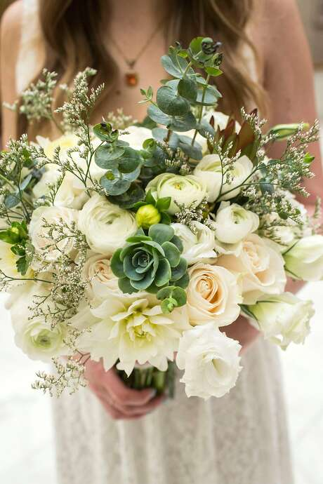 Kelsey Waldoch poses with her bouquet of flowers before her and Brad Meyer's wedding ceremony starts at City Hall. Photo: Jana Asenbrennerova, Special To The Chronicle