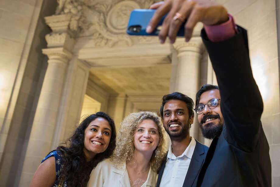Friends Soundarya Chandar (left) and Punit Rathore (right) flank Oakland couple Morgan Cohen and Anup Tapase taking a selfie before their City Hall wedding. Photo: Jana Asenbrennerova / Special To The Chronicle