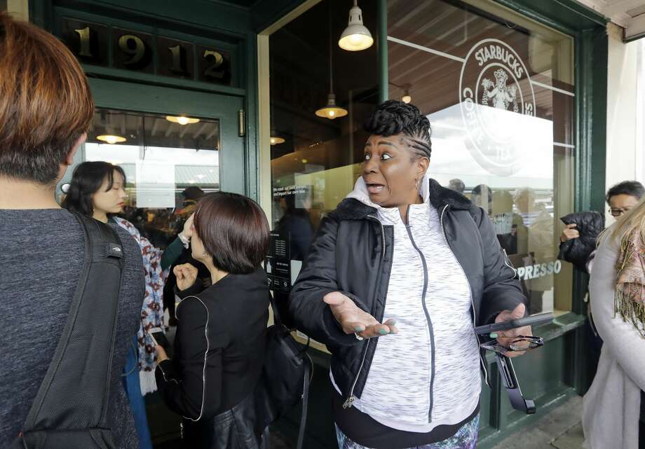 Visitor Trina Mathis, of Tampa, Fla., expresses her disappointment after arriving minutes too late to enter the Pike Place Market Starbucks, commonly referred to as the original Starbucks, Tuesday, May 29, 2018, in Seattle. The first Starbucks cafe was located nearby in the early 1970's. Starbucks closed more than 8,000 stores nationwide on Tuesday to conduct anti-bias training, the next of many steps the company is taking to try to restore its tarnished image as a hangout where all are welcome. (AP Photo/Elaine Thompson) Photo: Elaine Thompson/AP