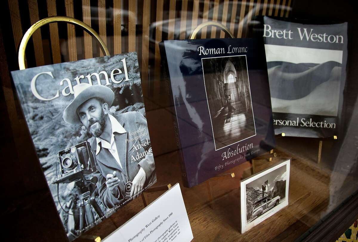 Photography books are on display in the front window of the Photography West Gallery in Carmel, Calif. on Tuesday, May 22, 2018. Carmel has played an important role in the history of photography.