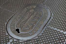 A metal cover put into place by the San Francisco Water Department is one of the more ornate covers found on the streets in San Francisco, Calif.,  on Friday, Nov. 20, 2009.
