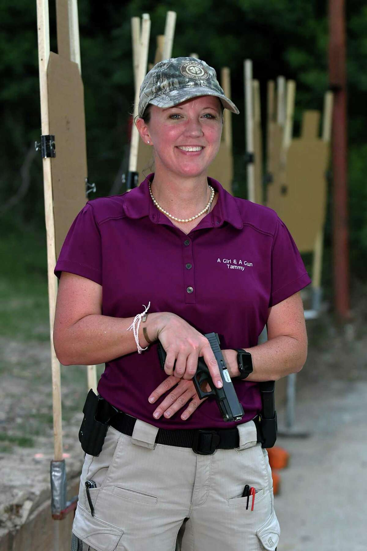 """Tammy Hunter is the Cypress chapter leader for """"A Girl and a Gun"""" women's shooting social group which practices at Hot Wells Shooting Range in Cypress. (Jerry Baker/For the Chronicle)"""