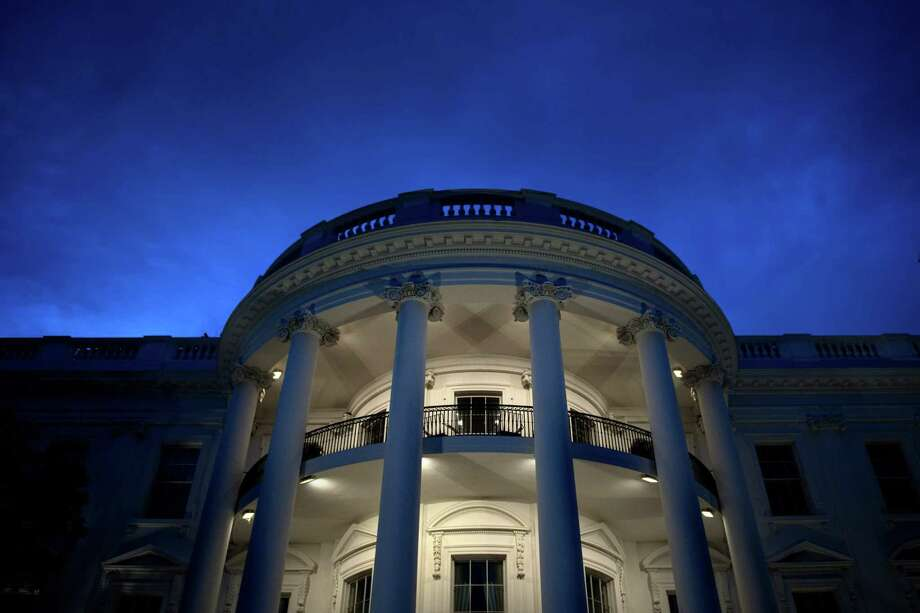 "This file photo taken on May 22, 2018, shows a view of the White House in Washington, DC. The White House said on May 29, 2018, the planned trade sanctions against China announced in March are still in the works, and details will be announced in the coming month. Despite announcing a truce in the trade hostilities, after US Treasury Secretary Steven Mnuchin said threatened tariffs on Chinese goods were ""on hold,"" the White House signaled it was ready to pull the trigger on a broad array of penalties. Photo: BRENDAN SMIALOWSKI /AFP /Getty Images / AFP or licensors"