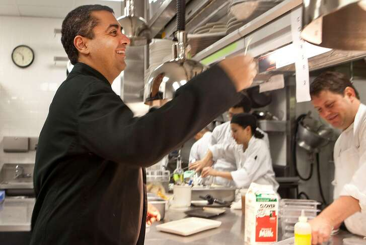 """Michael Mina walks in the kitchen and interacts with his employees in his new restaurant """"Michael Mina"""" in what used to be Aqua on Wednesday, Dec. 15, 2010 in San Francisco, Calif."""
