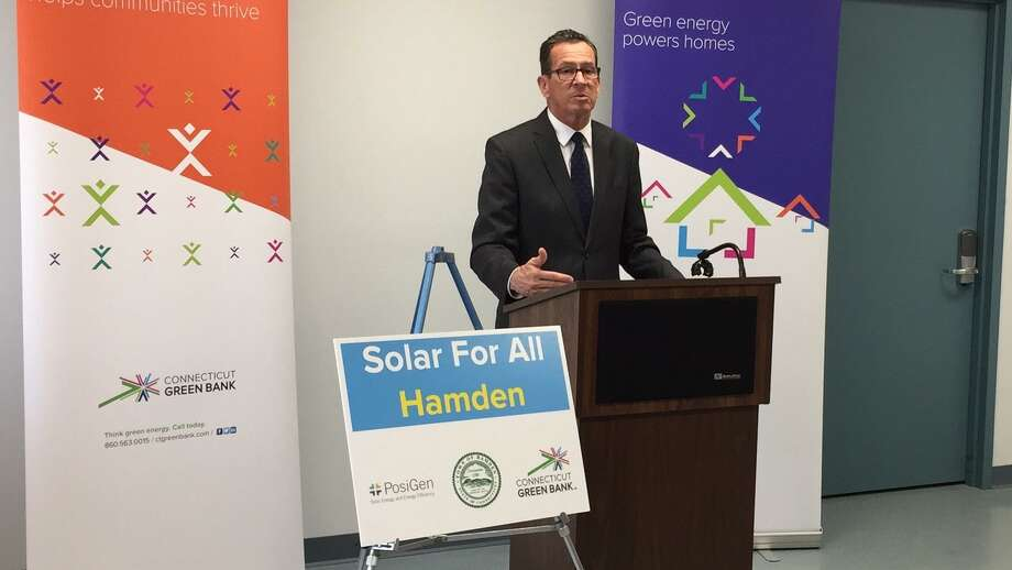 "Officials kicked off the ""Solar For All"" initiative this week at the Keefe Community Center in Hamden. Above, Gov. Dannel P. Malloy speaks. Photo: Ben Lambert / Hearst Connecticut Media"