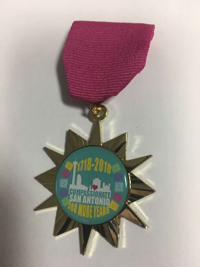 "Compassionate San Antonio's Fiesta medal represents the grass-roots movement promoting the city's commitment to be ""a world-class compassionate city."" Photo: Courtesy Photo"