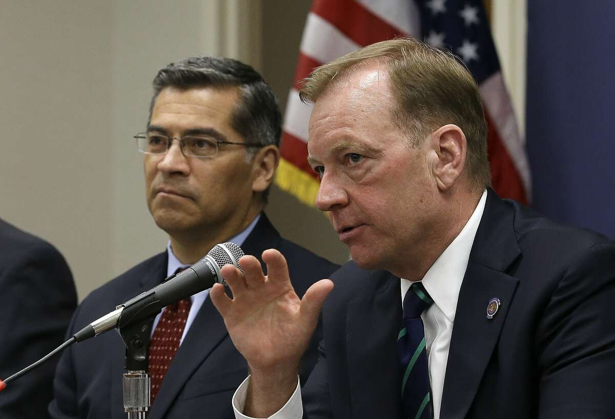 McGregor Scott, right, the United States Attorney for the Eastern District of California, accompanied by California Attorney General Xavier Becerra, discusses an increase in the use of a banned pesticide at illegal marijuana farms hidden on public lands Tuesday, May 29, 2018, in Sacramento, Calif. Researchers found the highly toxic pesticide Carbofuran, which can't legally be used in the Unites States, at 72 percent of grow sites last year, up 15 percent from 2012. (AP Photo/Rich Pedroncelli)