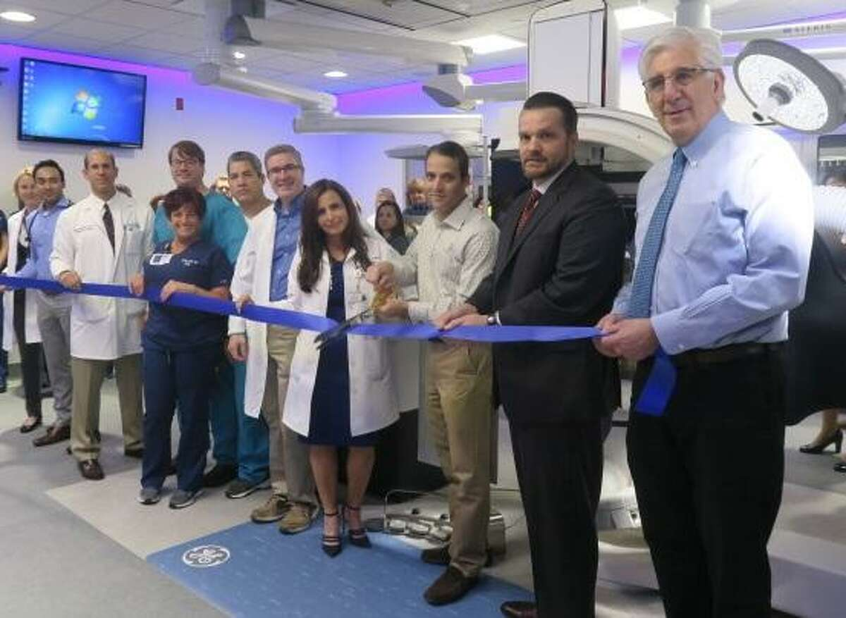 St. Vincent's Medical Center in Bridgeport had the ribbon cut on its new electrophysiology lab on Tuesday, May 29, 2018. Fromleft to right -- Dr. Anja Wagner, Dr. Venu Channamsetty, Dr. Rafael Squitieri, Chairmen of Cardiology, Dawson Haffner, RT., Rochelle Gibson, Charge Nurse, Diego Rosales, RT, Dr. Adam Lottick, Tina Strazza, Nurse Manager, Dr. Joseph Tiano, Medical Director EP Lab, Christopher Willey, VP Cardiology, Dr. Jeffrey Berman, Vice Chair Cardiology