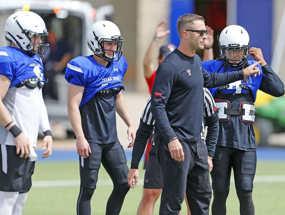 Texas Tech Head Coach Kliff Kingsbury gives instruction to the Red Raider quarterbacks in Saturday's scrimmage at Grande Communication Stadium. Photo: Wade H Clay