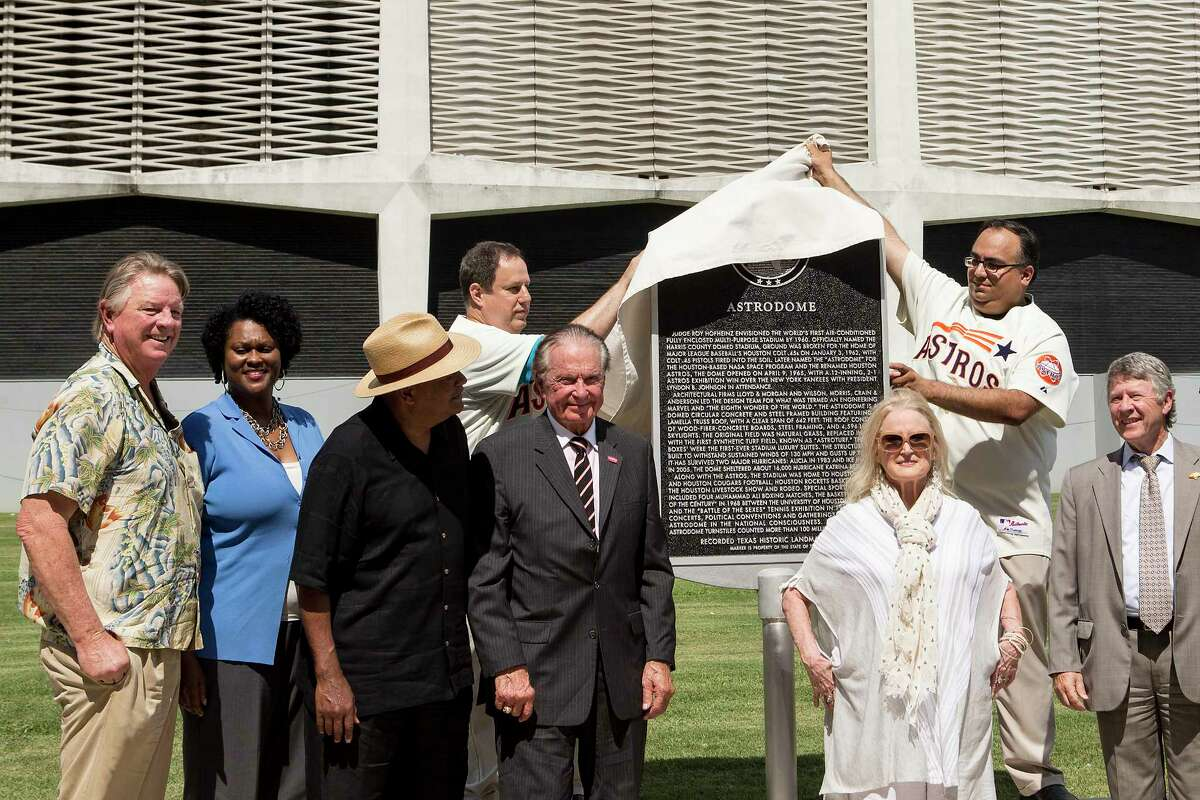 A Texas State Historical Marker, honoring the Astrodome, is unveiloed by Mike Vance and Mike Acosta during a ceremony on Tuesday, May 29, 2018, in Houston.