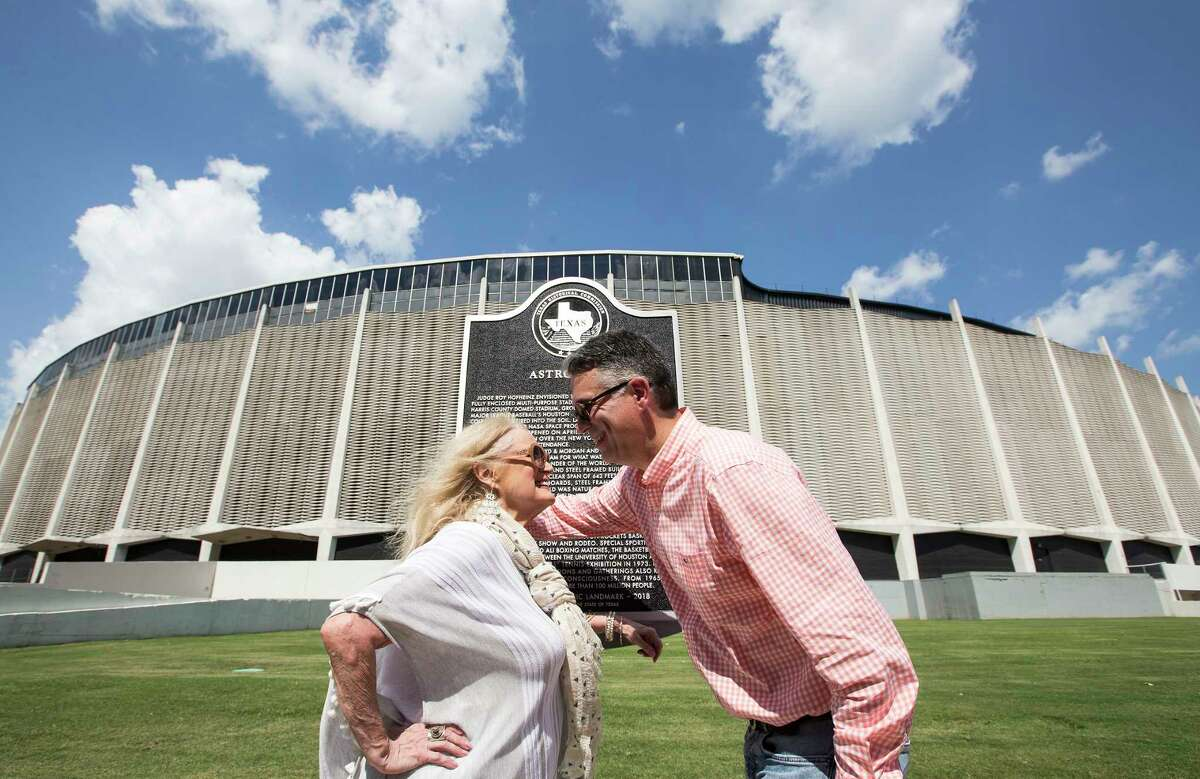 Dene Hofheinz, daughter of Judge Roy Hofheinz, embraces her son, Dinn Mann, following the dedication of a Texas State Historical Marker, honoring the Astrodome, on Tuesday, May 29, 2018, in Houston.