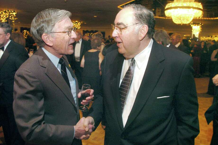 Norwalk_012006_Mayor's Ball: Two former Democratic Mayors, who show that the Mayor's Ball is a truly bi-partisan event in Norwalk, (L) William Collins and Frank Zullo shake hands and do a little governmental reminiscence. by Paul Desmarais/ Staff Photo: METRO Photo: ST