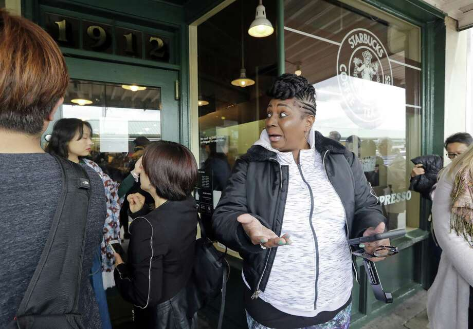 Visitor Trina Mathis, of Tampa, Fla., expresses her disappointment after arriving minutes too late to enter the Pike Place Market Starbucks, commonly referred to as the original Starbucks, Tuesday, May 29, 2018, in Seattle. The first Starbucks cafe was located nearby in the early 1970's. Starbucks closed more than 8,000 stores nationwide on Tuesday to conduct anti-bias training, the next of many steps the company is taking to try to restore its tarnished image as a hangout where all are welcome. Photo: Elaine Thompson /Associated Press / Copyright 2018 The Associated Press. All rights reserved.