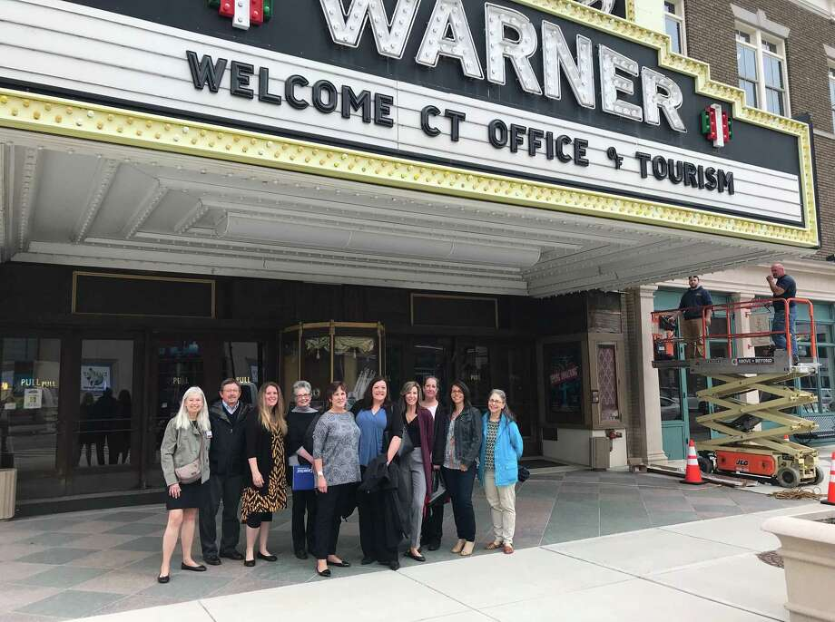 Connecticut Tourism Office representatives gather under the Warner's marquis during their recent visit to Torrington. Photo: Contributed Photo