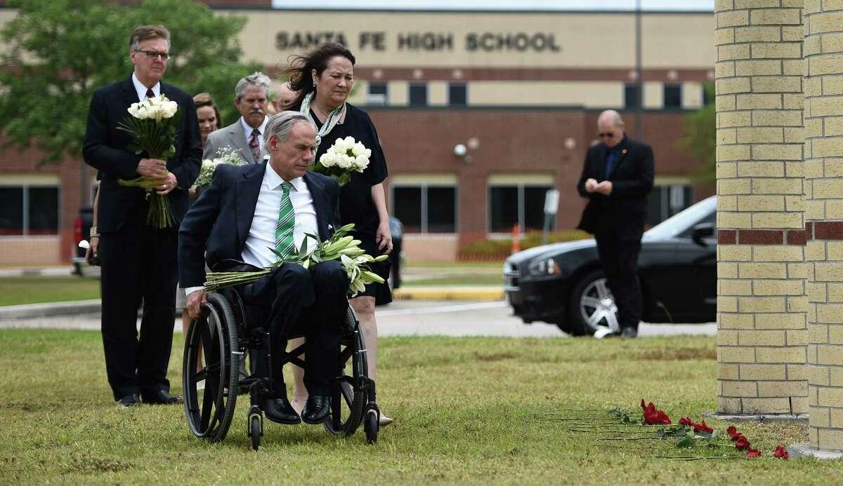 Gov. Greg Abbott, Lt. Gov. Dan Patrick and others at a memorial at Santa Fe High School.