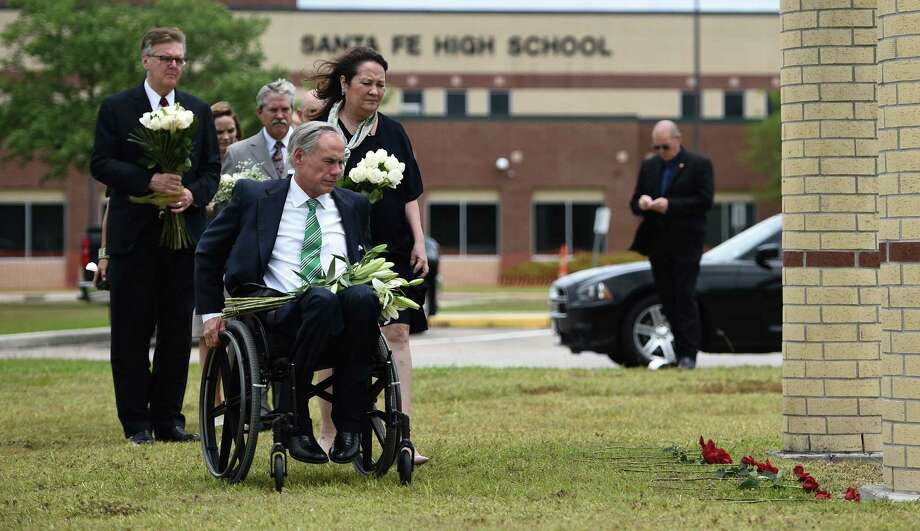 Gov. Greg Abbott, Lt. Gov. Dan Patrick and others at a memorial at Santa Fe High School. Photo: BRENDAN SMIALOWSKI, Contributor / AFP/Getty Images / AFP or licensors