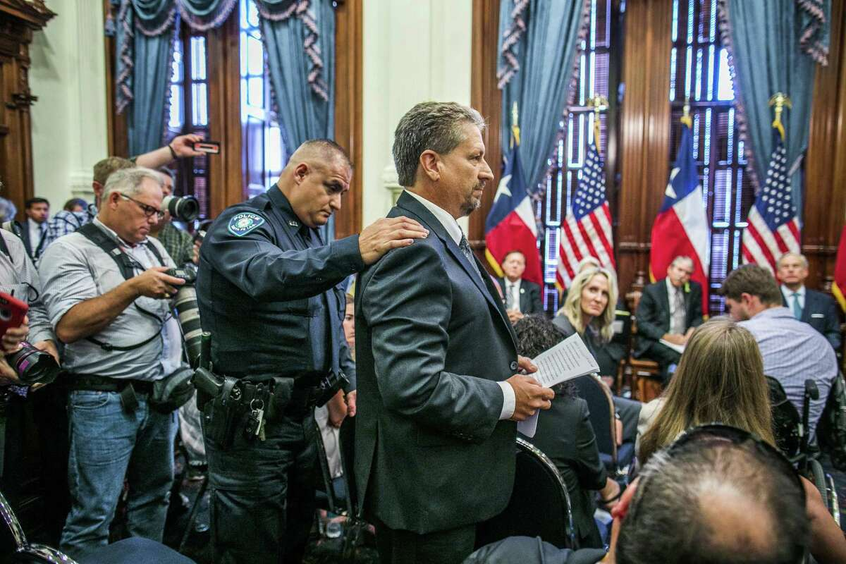 AUSTIN, TX - MAY 24: Scot Rice (R) addresses a panel about his wife, Flo Rice, being involved in the Santa Fe, Texas school shooting at the state capital on May 24, 2018 in Austin, Texas. Governor Greg Abbott held a roundtable discussion with victims, family, and friends affected by the shooting. (Photo by Drew Anthony Smith/Getty Images)