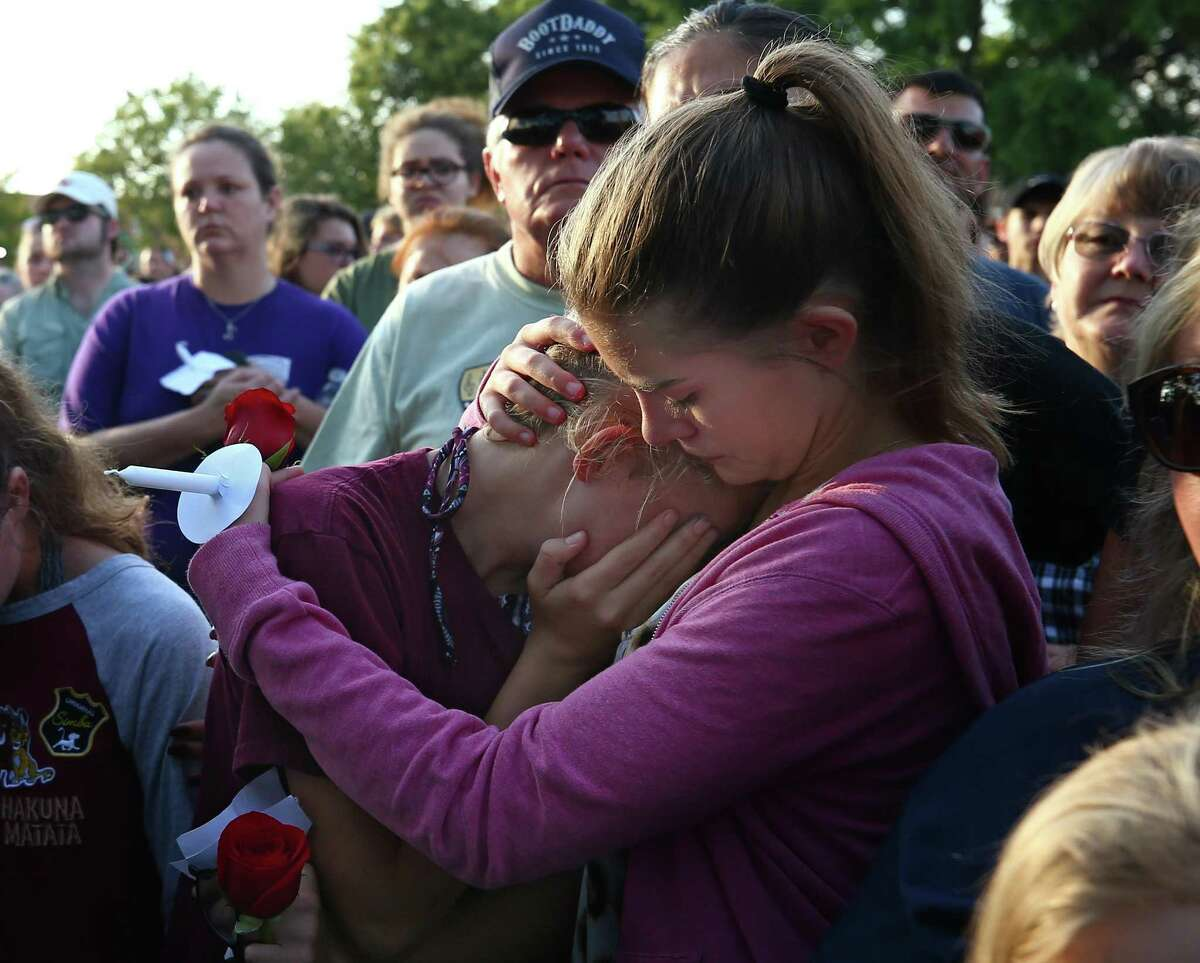 Abigail Adams, right, comforts her friend Hannah Hershey, 13, during a vigil Friday, May 18, 2018, for the victims of the Santa Fe High School mass shootingin Santa Fe, Texas. Hershey said she knew one of the 10 people who were killed at the high school earlier that day. ( Godofredo A. Vasquez / Houston Chronicle )