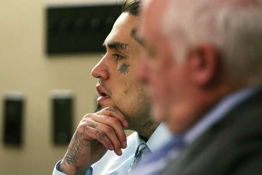 Daniel Lopez sits with his attorney J. Charles Bunk during his murder trial before Judge Ron Rangel in the Bexar County 379th Criminal District Court, Tuesday, May 29, 2018. Lopez is accused in the brutal beating death of Jose Luis Menchaca in September 2014. Menchaca was beaten with a baseball bat, suffocated, dismembered and his limbs cooked on a barbecue pit. His first trial last year resulted in a mistrial his girlfriend and co-defendant Candie Dominguez admitted during her testimony that she suffered from mental illness. Photo: JERRY LARA / San Antonio Express-News / San Antonio Express-News