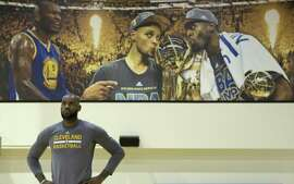 LeBron James takes a breather during a workout at Warriors headquarters in Oakland during the 2017 NBA Finals.