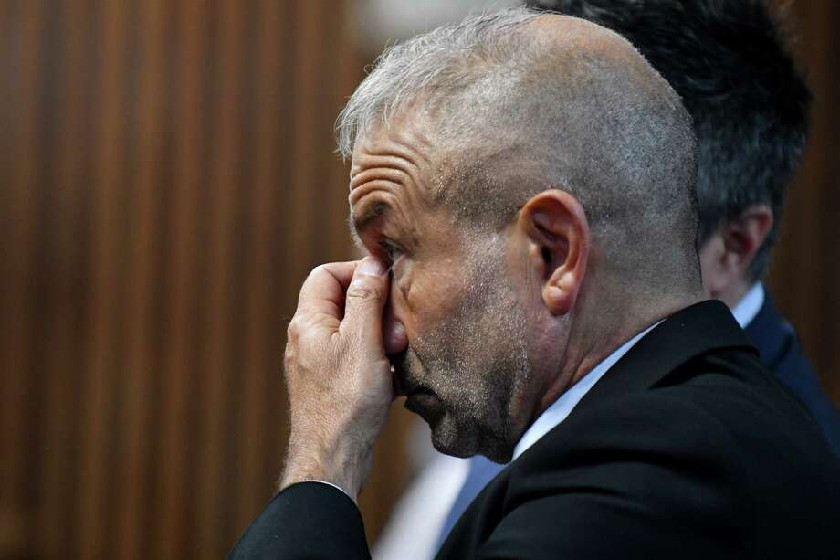 SUNY Polytechnic Institute Founding President and CEO Alain Kaloyeros awaits his arraignment on state charges while sitting in a courtroom at Albany City Courthouse on Friday morning, Sept. 23, 2016, in Albany, N.Y. (Will Waldron/Times Union) Photo: Will Waldron / 40038146A