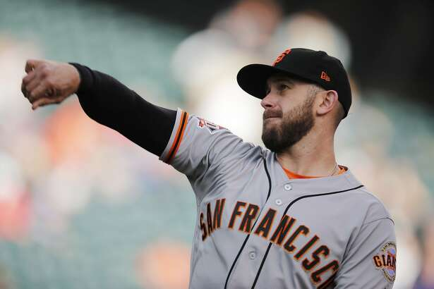 San Francisco Giants third baseman Evan Longoria warms up in the first inning of the team's baseball game against the Colorado Rockies on Tuesday, May 29, 2018, in Denver.(AP Photo/David Zalubowski)