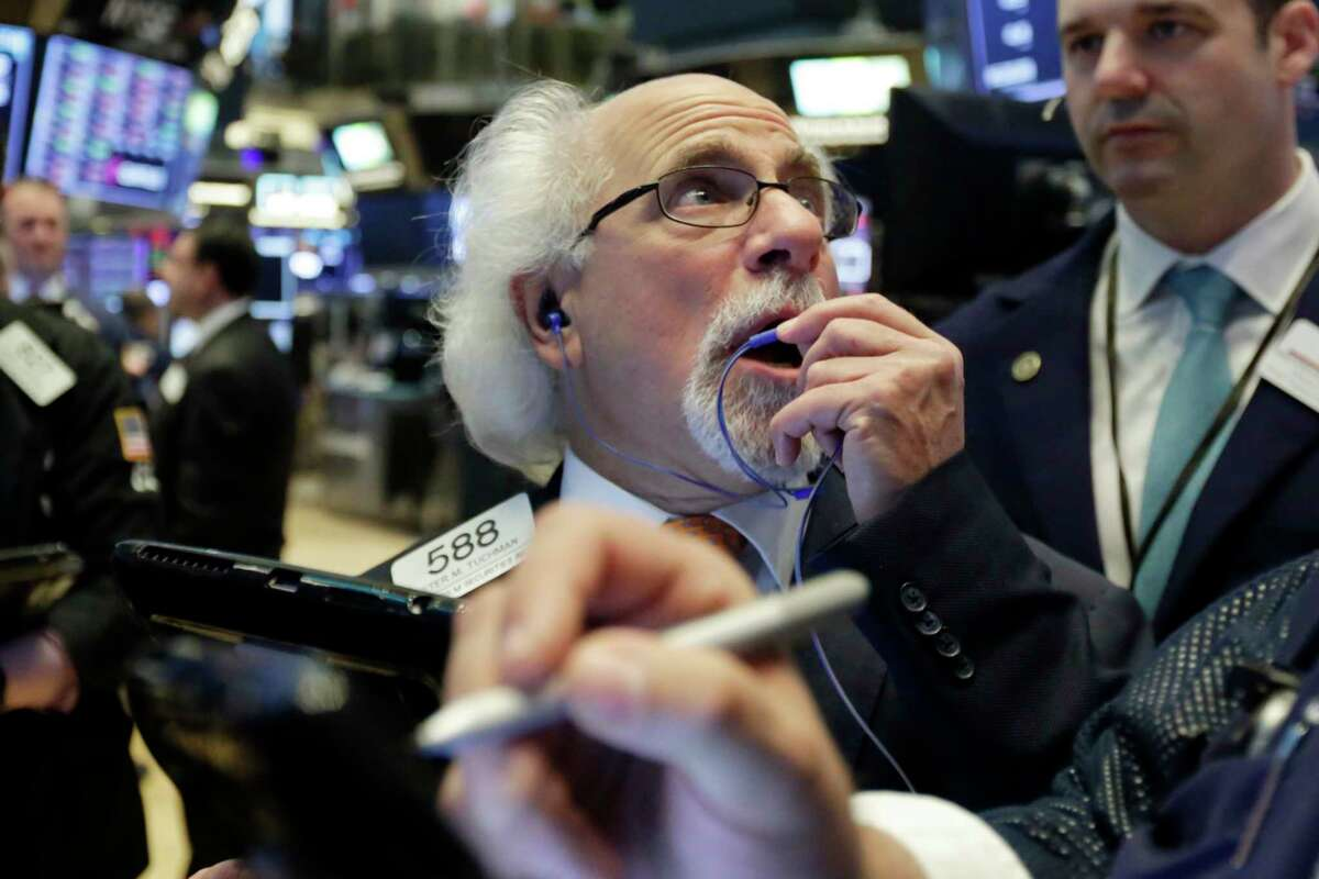 Trader Peter Tuchman works on the floor of the New York Stock Exchange, Tuesday, May 29, 2018. U.S. stocks are opening lower, following sharp drops in Europe triggered by political uncertainty in Italy. (AP Photo/Richard Drew)