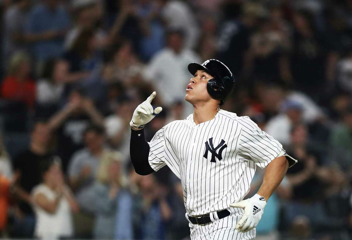NEW YORK, NY - MAY 29: Aaron Judge #99 of the New York Yankees rounds the bases after hitting a home run against Charlie Morton #50 of the Houston Astros in the fifth inning during their game at Yankee Stadium on May 29, 2018 in New York City.