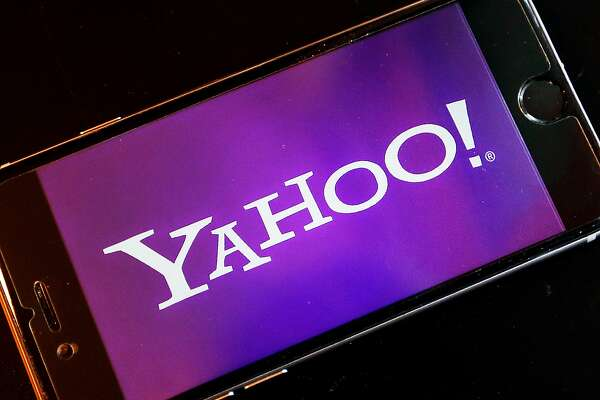 FILE - In this Dec. 15, 2016, file photo, the Yahoo logo appears on a smartphone in Frankfurt, Germany. Watching NFL games free on your phone used to be mainly limited to Verizon customers. Soon anyone will be able to download Yahoo�s app and watch football games on the go. Verizon�s new deal with the NFL goes into effect in January 2018 and will last for several years. Verizon bought Yahoo in June 2017 and is trying to build a digital ad business to rival Facebook and Google. (AP Photo/Michael Probst, File)