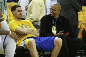 Warriors guard Klay Thompson and his father Mychal Thompson chat before the Warriors play the Rockets in Game 1 of the Western Conference finals.