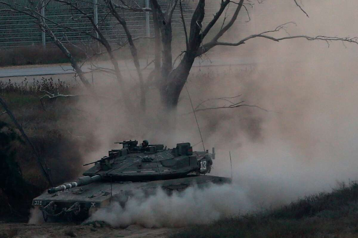 An Israeli tank drives along the border with the Gaza strip, on Israel-Gaza Border, Tuesday, May 29, 2018. Palestinian militants in the Gaza Strip fired at least 50 rockets and mortars into southern Israel on Tuesday, the largest barrage since the 2014 war between Israel and Hamas. Tensions have soared over the past two months as the Palestinians have held mass protests along the Gaza-Israel frontier. Israeli fire has killed more than 100 Palestinians and wounded thousands at the protests since March. (AP Photo/Ariel Schalit)