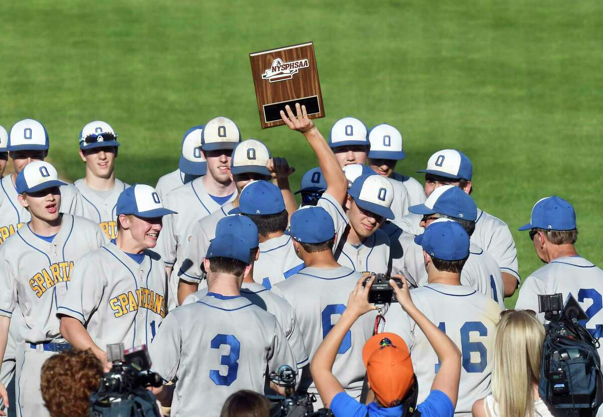 Queensbury players celebrate a 5-2 win against Amsterdam during a Section II Class A Boys' baseball final Tuesday, May 29, 2018, in Troy, N.Y. Queensbury won the game (Hans Pennink / Special to the Times Union)