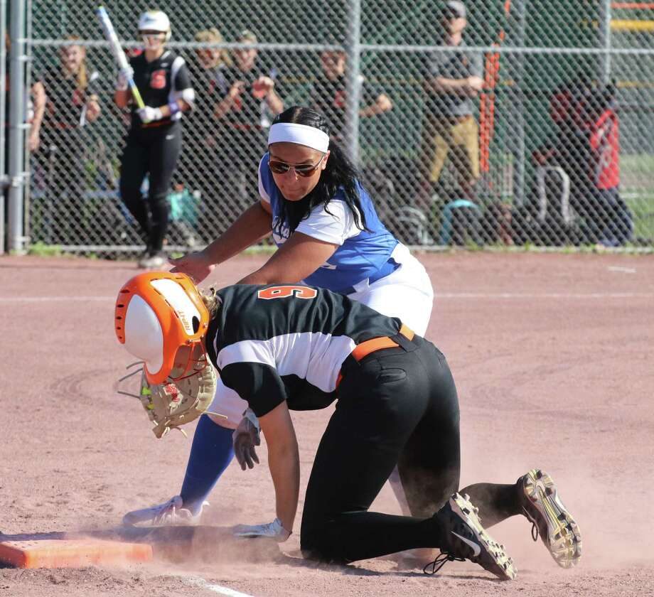 Schuylerville's Emily Vallee is safe back at 1st as Ichabod Crane's Alexandria McKearin tries for the out during the Section II Class B softball final at Luther Forest Athletic Fields in Malta Tuesday, May 29, 2018. (Ed Burke - Special to The Times Union)