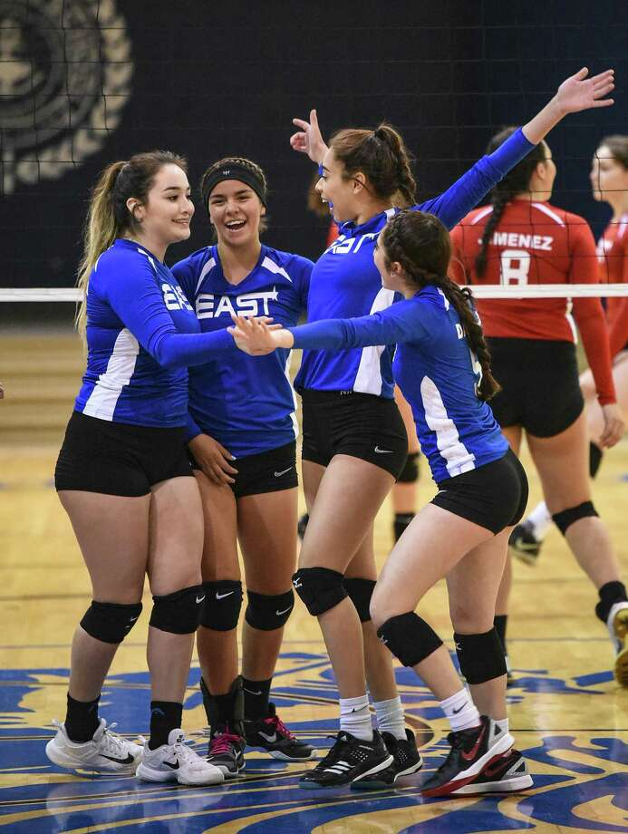 The East team celebrates after scoring a point during the Bosom Buddies All-Star game at St. Augustine. The East won with a 3-0 (25-6, 25-12, 26-24) sweep. Photo: Danny Zaragoza /Laredo Morning Times
