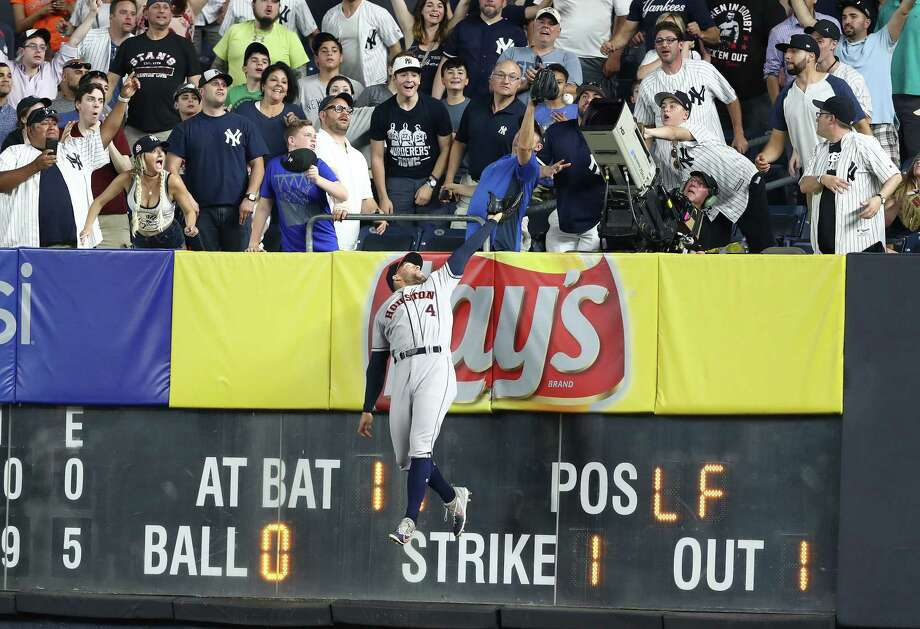 Astros center fielder George Springer can't get to Brett Gardner's two-run homer that tied the score during the ninth inning of Tuesday's 6-5 Yankees victory in 10 innings. Photo: Al Bello, Getty Images / 2018 Getty Images
