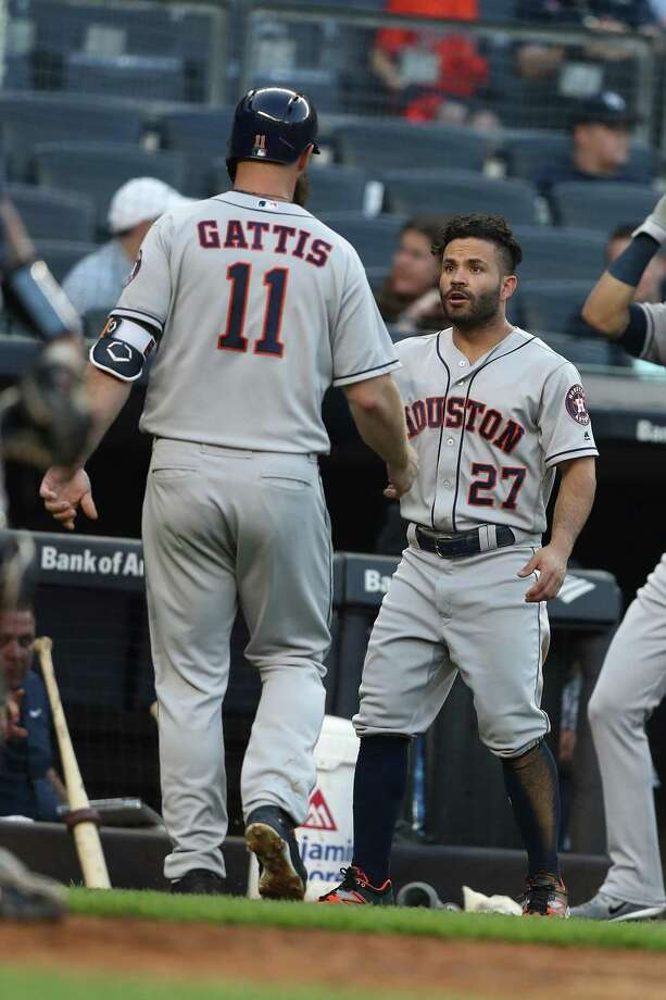 Jose Altuve, right, greets Evan Gattis' after his second-inning homer for the first of Gattis' two RBIs on Tuesday night. Photo: Al Bello, Staff / Getty Images / 2018 Getty Images