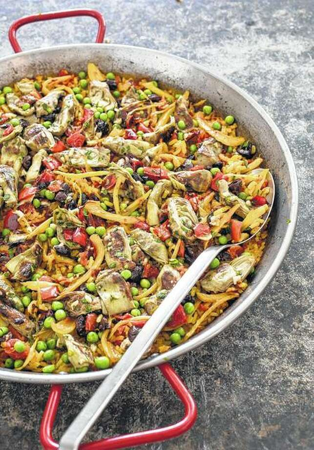Vegetable paella features the traditional flavors and concepts of Spanish paella but puts the focus on Spain's hearty vegetables. Photo:       Carl Tremblay | America's Test Kitchen Via AP