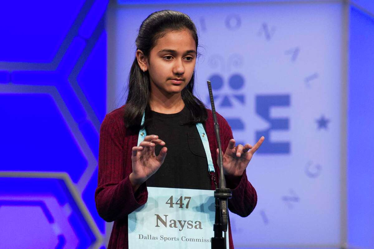 Naysa Modi, 12, from Frisco, Texas, spells her word correctly during the 2nd Round of the Scripps National Spelling Bee in Oxon Hill, Md., Tuesday, May 29, 2018.