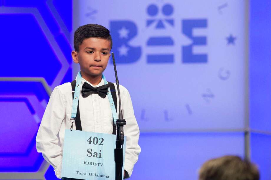 Saisurya Lakkimsetti, 9, from Tulsa, Okla., correctly spells his word during the 2nd Round of the Scripps National Spelling Bee in Oxon Hill, Md., Tuesday, May 29, 2018. Photo: Cliff Owen, AP / FR170079 AP