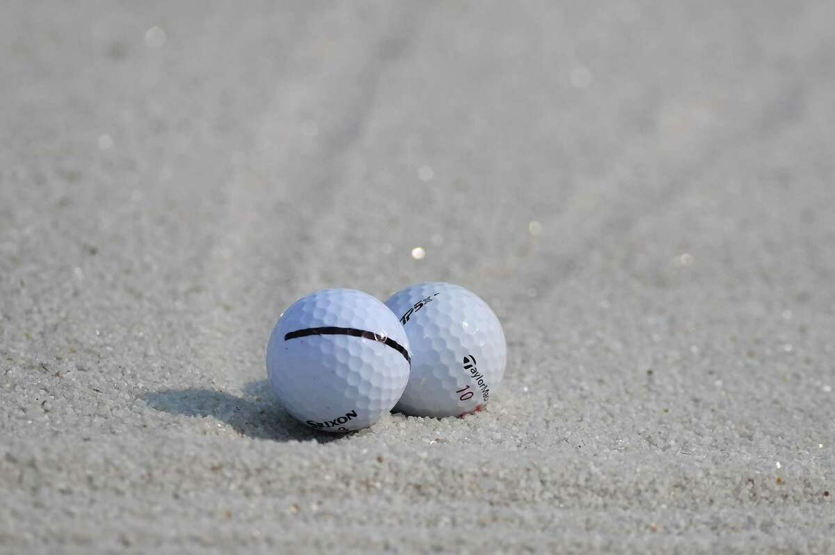 The balls of Hideki Matsuyama of Japan and Jon Rahm of Spain sit touching in a bunker on the 18th hole during the second round of the WGC - HSBC Champions at Sheshan International Golf Club on October 27, 2017 in Shanghai, China. (Photo by Ross Kinnaird/Getty Images)