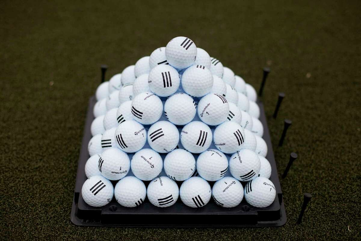Golf balls sit stacked on the practice field. MUST CREDIT: Bloomberg photo by Victor J. Blue.